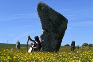 Harpist by sarsen stone