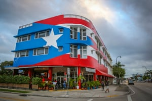 Outside La Placita, a restaurant by chef José Mendín that takes a modern approach to Puerto Rican food. The restaurant was opened in the aftermath of Hurricane Maria and it's building is decorated by the Puerto Rican flag, which has become an iconic sight among the Miami skyline.