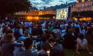 A free film festival in Square Louis XIII, Place de Vosges, Paris.