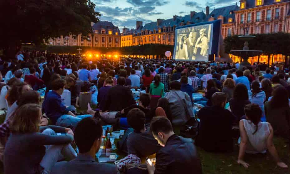 Open-air cinema in Place des Vosges, Paris.