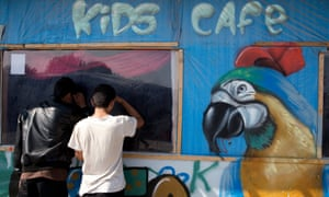 Two youngsters peer into the Kids Cafe in the Calais refugee camp known as the Jungle.