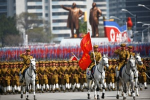 North Korean soldiers, some of them on horses, march during a military parade marking the 105th birth anniversary of country's founding father Kim Il Sung