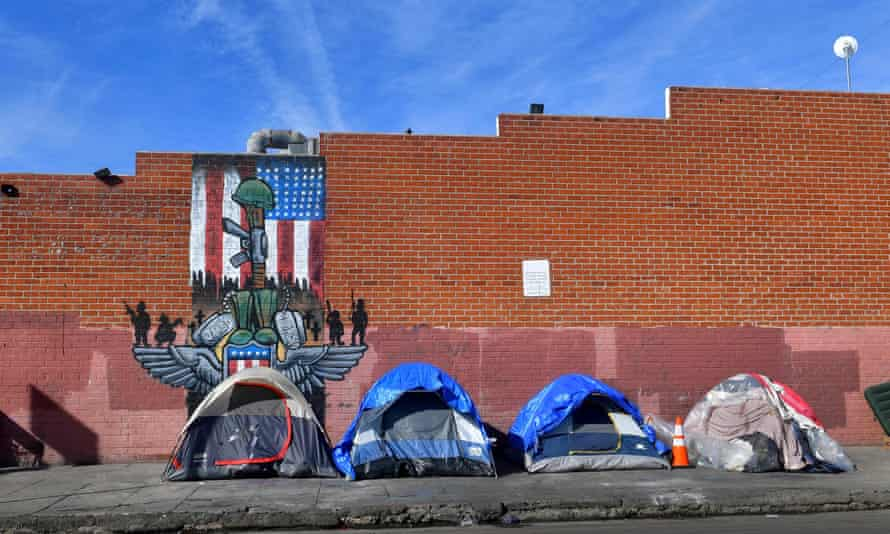 Tents for homeless people line a sidewalk in Los Angeles, California. Trump has used the crisis to attack opponents.