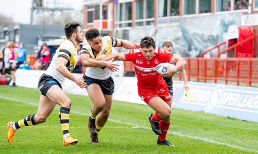 Niall Evalds and Derrell Olpherts tackle Ryan Hall during a game between Hull KR and Castleford earlier this year.