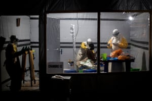Health workers treat an unconfirmed Ebola patient, inside an MSF-supported Ebola treatment centre in Butembo, Democratic Republic of the Congo