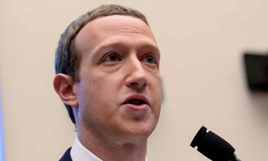FILE PHOTO: Facebook CEO Zuckerberg testifies about cryptocurrency Libra at House Financial Services Committee hearing on Capitol Hill in Washington<br>FILE PHOTO: Facebook Chairman and CEO Mark Zuckerberg testifies at a House Financial Services Committee hearing examining the company's plan to launch a digital currency on Capitol Hill in Washington, U.S., October 23, 2019. REUTERS/Erin Scott/File Photo