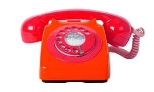 a red 1970s style telephone