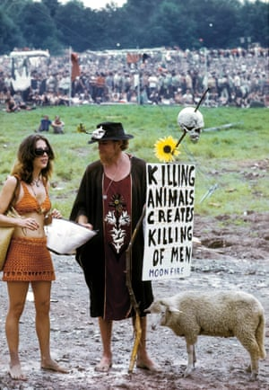 """Bethel, New York: Woodstock Music Festival. Couple with a lamb. Young man holding sign saying """"Killing Animals Creates Killing of Men"""" ML """"Lewis and his sheep……Lewis lived with the lamb, he was a local character""""."""
