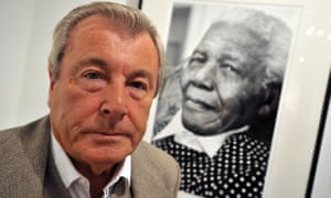 Terry O'Neill in front of his work 'Nelson Mandela at 90' in 2009.