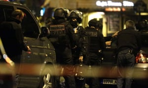 Police officers secure the area around the Bataclan theatre