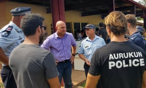 Queensland minister Curtis Pitt with police in Aurukun during a visit to the troubled community in November 2015.