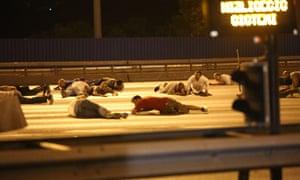 People take cover on the Bosphorus bridge