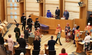 The Queen and the Duke of Rothesay watch as The Duke of Hamilton carries the Crown of Scotland into the Scottish Parliament in Edinburgh during a ceremony marking the 20th anniversary of devolution in the Holyrood chamber