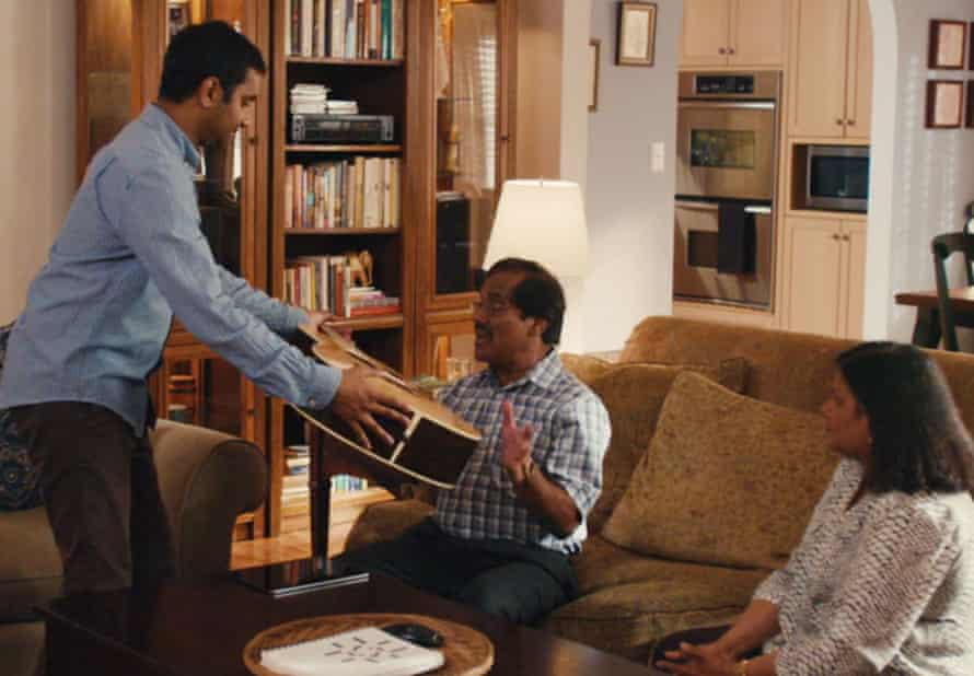 Ansari as Dev in a scene from Master of None, with his parents, played by his real-life parents Shoukath and Fatima Ansari.