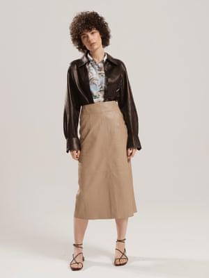 model wears  Hawaiian shirt, £15, topshop.com. Skirt, £225, plain shirt, £43, and sandals, £125, all arket.com.