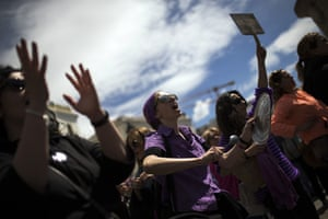 Women shout slogans during a protest against five men's acquittal of gang rape charges and their conviction on a lesser felony of sexual abuse.
