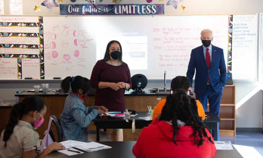 Joe Biden, alongside teacher Michelle Taylor, speaks to students in a 6th grade science class, at Brookland middle school in Washington DC last month.