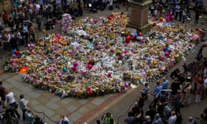 Crowds gathering in St Ann's Square in Manchester to lay flowers and dedications to remember the 22 people killed in a terrorist bomb attack at the Manchester Arena three days earlier.