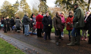 Onlookers wait in vain for the Queen's arrival at the church near the Sandringham estate.