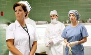 Marcia Gay Harden (left) and Zac Efron (centre) in Parkland.