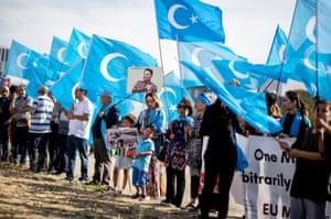 Demonstrators holding Uighur flags in Berlin before a meeting between German chancellor Angela Merkel and Chinese premier Li Keqiang.