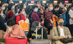 Travellers at the departure hall of West Kowloon Station on 23 January in Hong Kong, China.