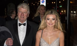 Stanley Johnson, father of Boris Johnson, and Georgia Toffolo, reality TV star, arrive for the ball.