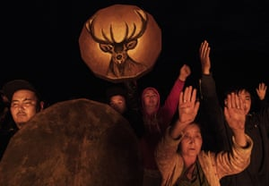 Followers of shamanism pray in a fire ritual