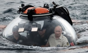 Cruising along: Putin gets to grips with his new surroundings before the dive