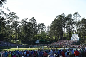 Patrons cheer as Sergio Garcia celebrates making a putt for eagle on the 15th