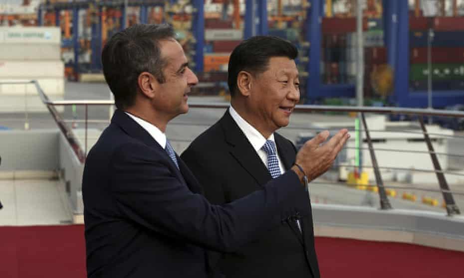 Greece's prime minister, Kyriakos Mitsotakis, shows Xi Jinping around Piraeus port near Athens.