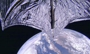 The LightSail 2 spacecraft gliding above Earth, after the successful deployment of its solar sail