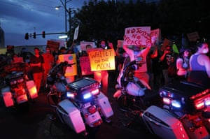 Protesters rally Saturday, May 30, 2020, in Las Vegas, over the death of George Floyd, a black man who was in police custody in Minneapolis. Floyd died after being restrained by Minneapolis police officers on Memorial Day.
