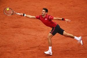 Djokovic hits a forehand.