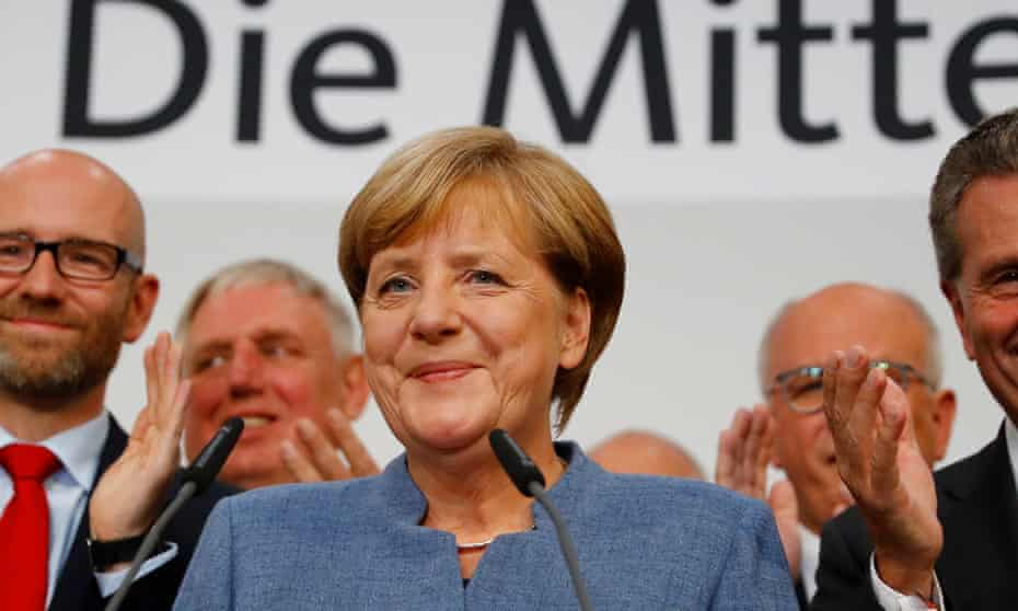 German Chancellor Angela Merkel reacts to first exit polls in the German general election in Berlin.