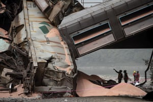 British Columbia, CanadaOfficials look over the scene where a train carrying potash derailed near Hope. CN Rail says at least 20 rail cars carrying potash derailed.