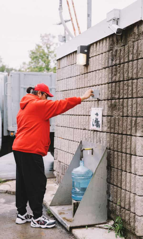 Ken Greene gathers water for his home.