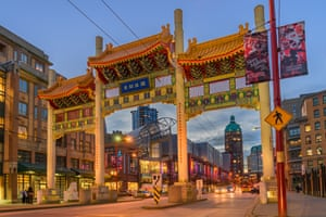 The Millenium Chinatown Gate with the Sun Tower in the distance, West Pender Street, Vancouver, British Columbia, Canada
