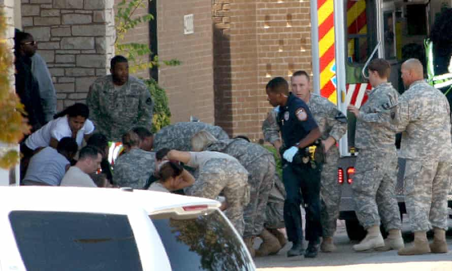 First responders prepare the wounded for transport in waiting ambulances outside Fort Hood's soldier readiness processing center.