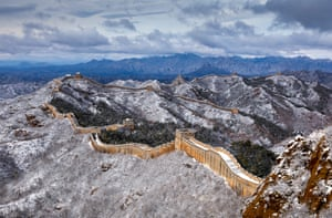 Snow lies on part of the six-mile Jinshanling section of the Great Wall of China in the mountainous area of Chengde.