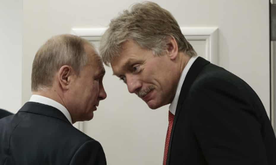 Vladimir Putin speaks with Kremlin's spokesman Dmitriy Peskov