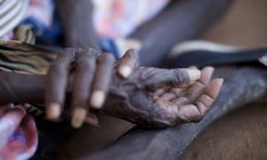 Hands of an elderly Indigenous woman