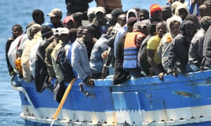 Immigrants arrive on the island of Lampedusa, southern Italy, on 9 April 2011.