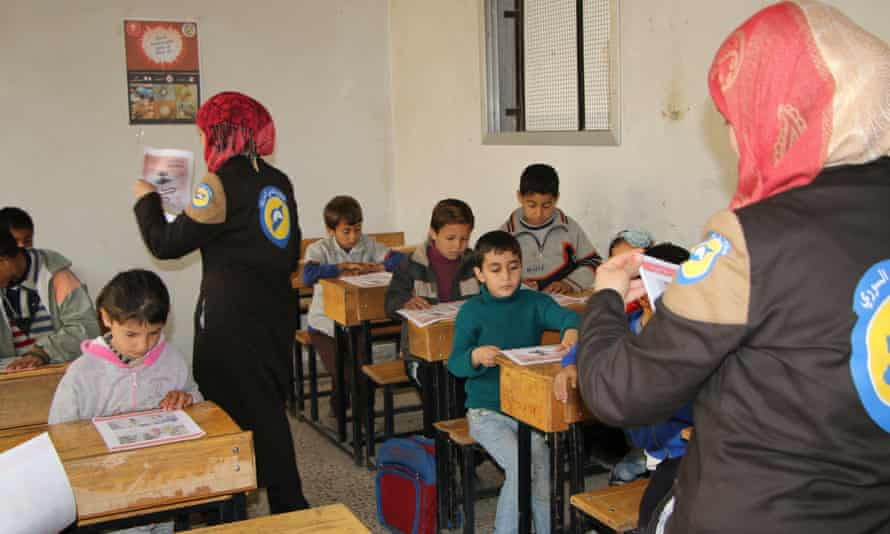 Children are shown how to protect themselves during airstrikes