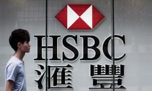 A man walks past an HSBC branch in Hong Kong.