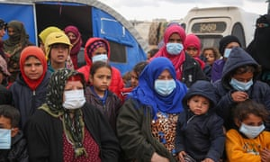 Displaced Syrians, some wearing protective masks, pictured earlier this year in the northwestern province of Idlib.