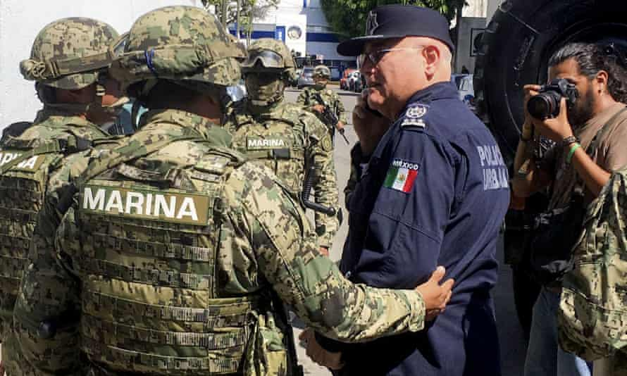 Troops from the Mexican navy escort Acapulco public security chief Max Lorenzo Sedano