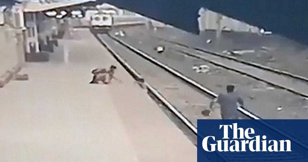 Railway worker saves boy from being run over by train – video