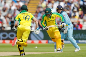 Smith and Carey run between the wickets while Australia reaches 100.