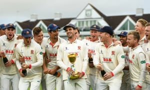 Essex players celebrate their triumph at Taunton.